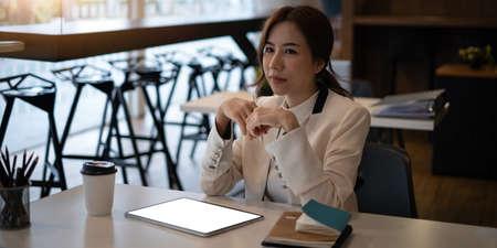 Fashion asian woman designer using digital tablet.