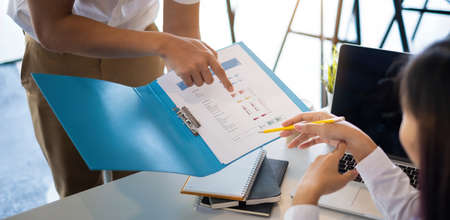 Businessman and team try to explain about his work at home office. Account, tax, financial concept. Stock Photo