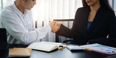 Finishing up meeting. Business and partners handshaking and agree make big project. Stock Photo
