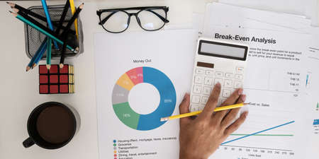 Fund managers researching and analysis Investment stock market by paperwork.