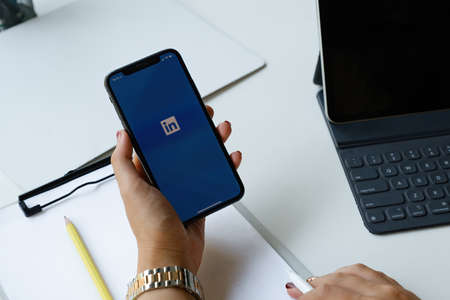 CHIANG MAI, THAILAND: APR 17, 2021 : LinkedIn logo on phone screen. LinkedIn is a social network for search and establishment of business contacts. It is founded in 2002. Editorial