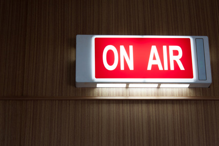 on air sign on wood background photo