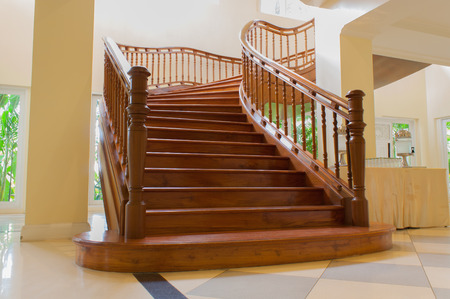 the wood stair is interior in the building  this is a luxury style. photo