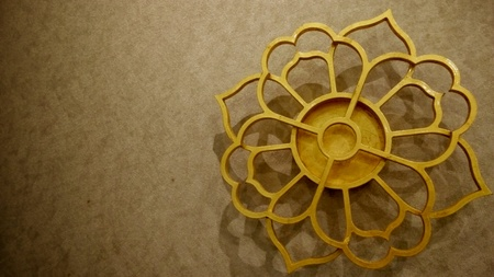 gold: Gold flower and brown wall