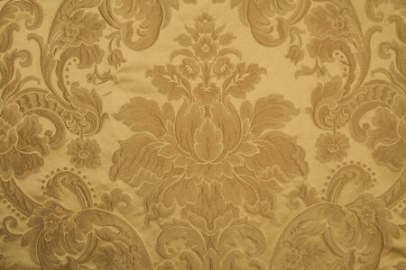 Pattern on brocade fabric, flowers and geometric elements. Color: Golden