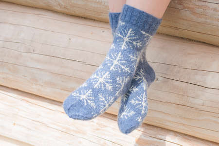 Pair of knitted socks with snow flakes