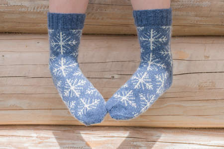 Pair of knitted socks with snow flakes for winter