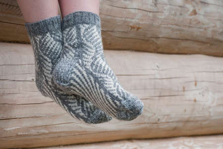 Pair of knitted socks for winter