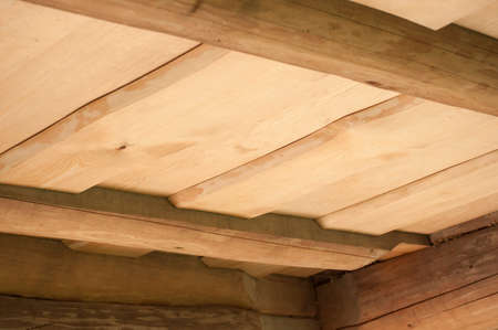 Closeup of ceiling of wooden planks from pine without peel for log house