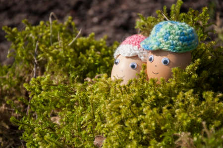 Couple of cute eggs with face for Easter decoration in spring sunlight Stock Photo