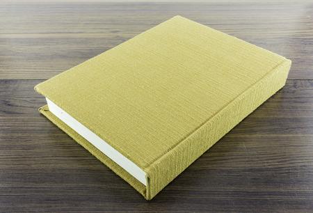 memorise: brown fabric notebook on wood Stock Photo