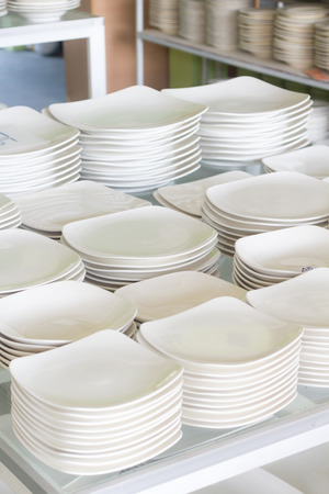 A lot of white plates in a shop photo