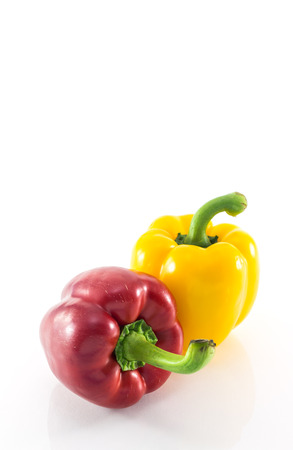 solated on white: Red and yellow peppers solated on white