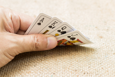 double the chances: Closeup of hands with playing cards Stock Photo