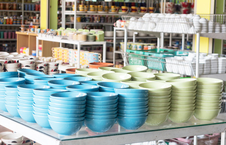 A lot of colorful bowls in a shop photo