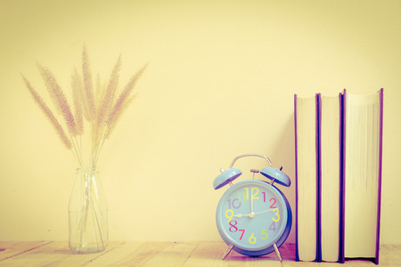 Alarm clock with book - Vintage effect style pictures photo