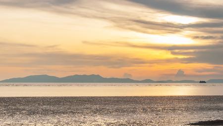 orange sunset: Cloudy orange sunset over sea