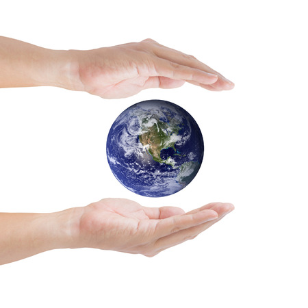 Human hands carrying global Earth. Environment concept.