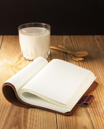 note book: Open note book leather with milk Archivio Fotografico