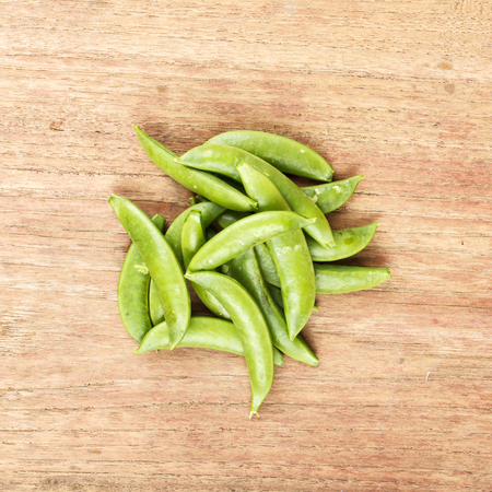 snap: Sugar snap pea on wooden table Stock Photo