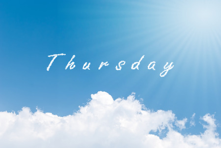 the thursday: Blue sky background with thursday clouds word Stock Photo