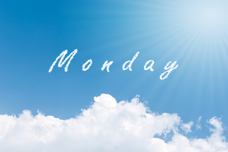 Blue sky background with monday clouds word 스톡 콘텐츠