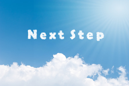next: Blue sky background with next step clouds word Stock Photo