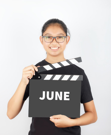 JUNE, message on slate film show by Asian girl