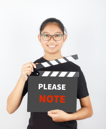 take down notice: PLEASE NOTE, message on slate film show by Asian girl Stock Photo