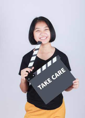 health concern: TAKE CARE, message on slate film show by Asian girl