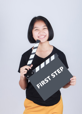 first step: FIRST STEP, message on slate film show by Asian girl