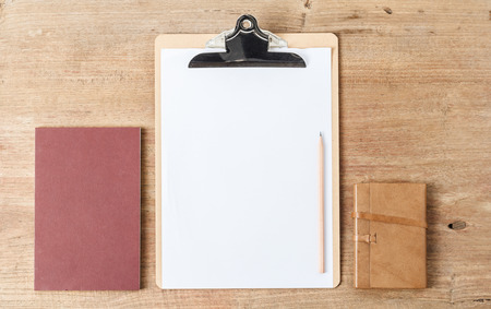 moleskin: Notebook with clip board on wood, Business template mock up for adding your text