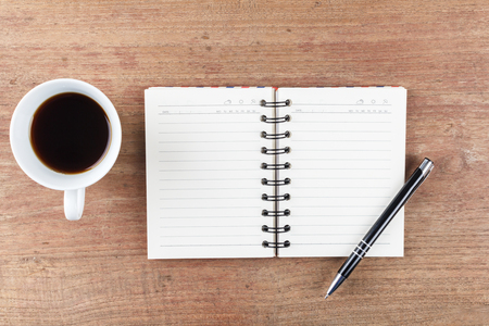 moleskin: Blank open notebook with coffee cup, Business template mock up for adding your text Stock Photo