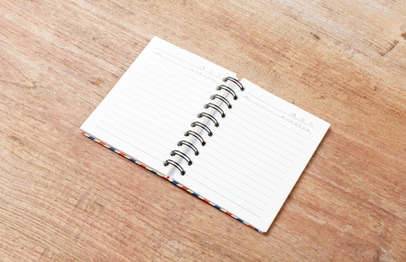 kine: Blank open notebook on wood table,Business template mock up for adding your text
