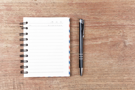 kine: Blank open notebook with black pencil on wood table,Business template mock up for adding your text