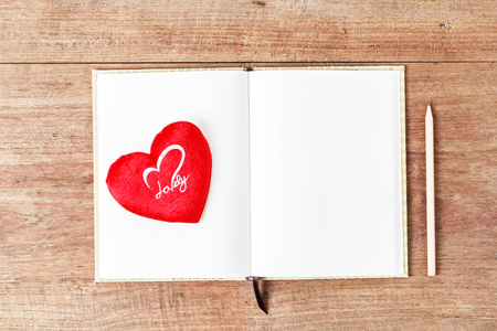 Blank open notebook with red heart, Business template mock up for adding your text, selective focus