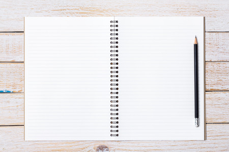 moles: Blank open notebook on white wooden background, Business template mock up for adding your text Stock Photo