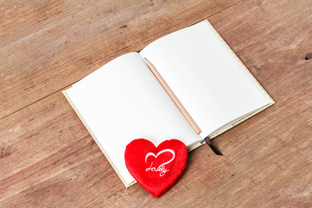 moles: Blank open notebook with red heart, Business template mock up for adding your text, selective focus