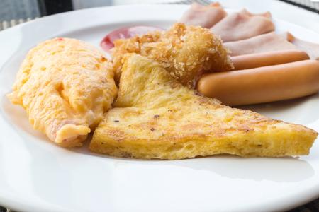 garnished: Breakfast set , omelete, sausage, ham