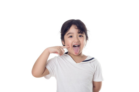 Portrait of happy little Asian child finger up on isolated background Stock Photo