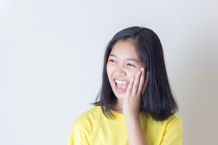 Surprised excited girl on white background. Cheerful multiracial Asian Stock Photo