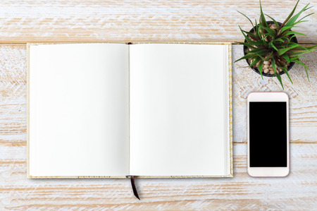 moles: Blank open notebook with smartphone, Business template mock up for adding your text Stock Photo