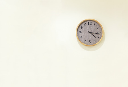working hours: Clock on wall Stock Photo