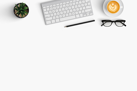Modern workspace with coffee cup, smartphone and paper copy space on white color background. Top view. Flat lay style. 版權商用圖片