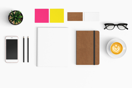 Modern workspace with coffee cup, smartphone, paper, notebook, tablet copy space on white color background. Top view. Flat lay style.