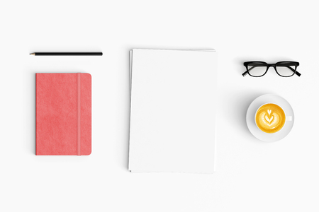 Modern workspace with coffee cup, paper, and notebook copy space on white color background. Top view. Flat lay style.