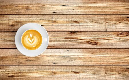 Modern workspace with coffee cup copy space on wood background. Top view. Flat lay style. 스톡 콘텐츠