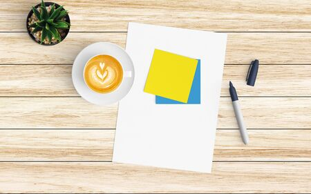 Modern workspace with coffee cup, blank paper, notebook and tablet or smartphone copy space on wood background. Top view. Flat lay style. 스톡 콘텐츠