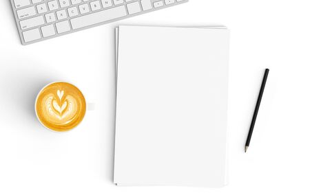 Modern workspace with coffee cup and blank paper copy space on white color background. Top view. Flat lay style.