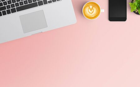 Modern workspace with coffee cup, smartphone and laptop copy space on pink color background. Top view. Flat lay style. 스톡 콘텐츠